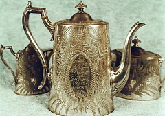 jug(0.0), drinkware(0.0), mug(0.0), silver(0.0), iron(0.0), porcelain(0.0), pitcher(1.0), metal(1.0), tableware(1.0), antique(1.0), teapot(1.0), brass(1.0),