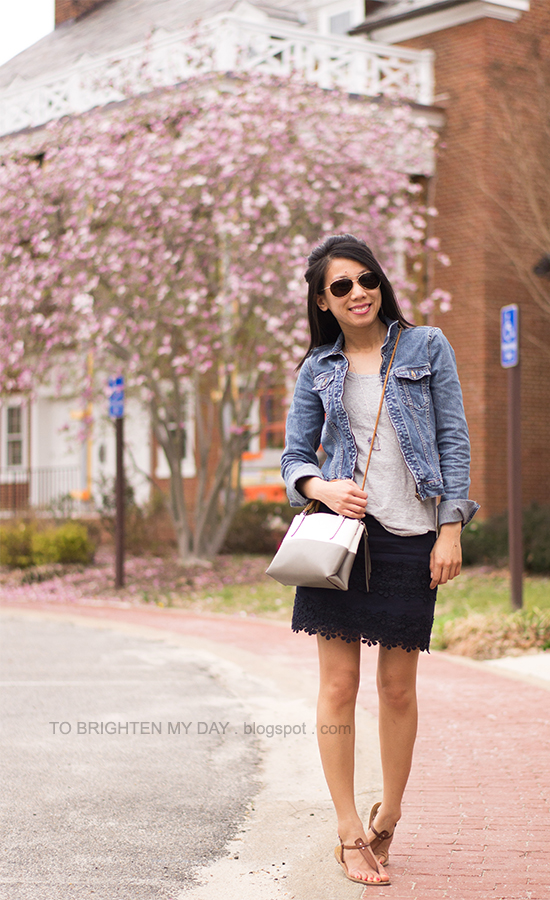 denim jacket, gray tee, navy lace skirt, striped crossbody bag