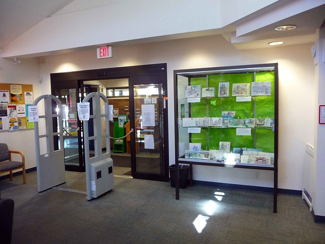 Entrance to the Oak Bay Library with urban sketchbooks display