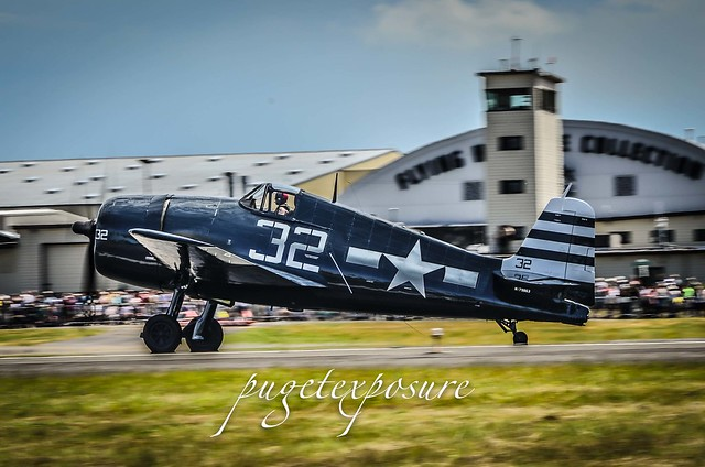 Grumman F6F-5N Hellcat with Kevin Eldredge at the controls accelerates down the runway
