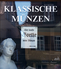 Window sign telling that Goethe purchased his coins here