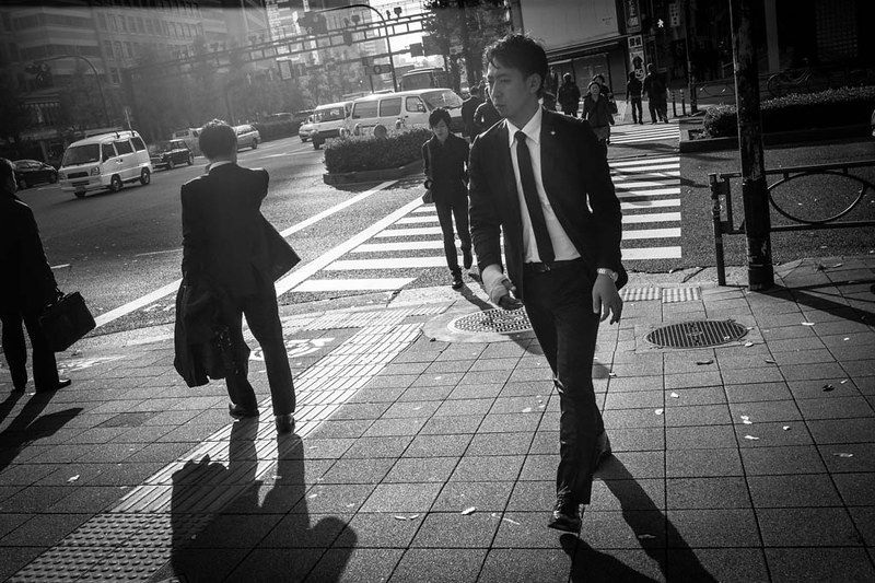 A man with a bandaged right hand heading to work early in the morning. Shinjuku, Tokyo