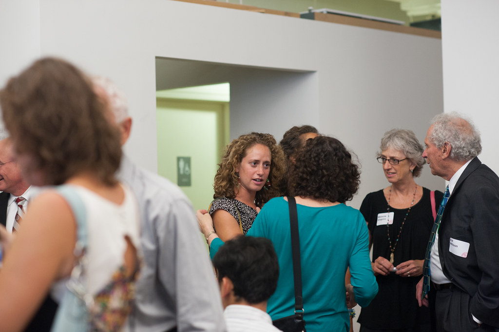 Guests socializing after the lecture.