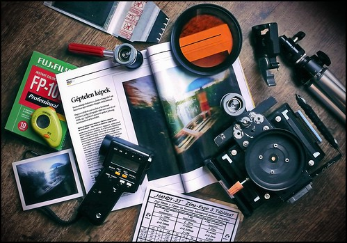 My instant pinhole photography set, my instant pinhole photo and an article about me in the National Geographic magazine.