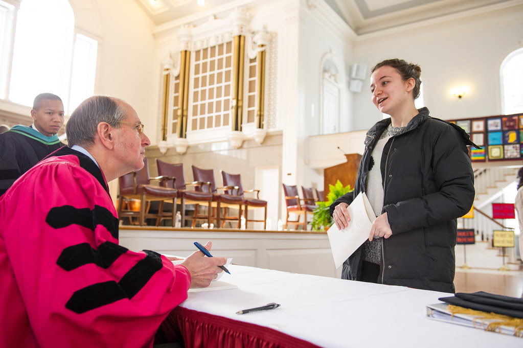 "Founders Day keynote speaker Dr. Alfred Sommer '63 autographs his recent book, ""Ten Lessons in Public Health: Inspiration for Tomorrow's Leaders,"" for Dorothy Hazan '16.  Sommer's pioneering research on vitamin A deficiencies has established him as a global leader in public health."