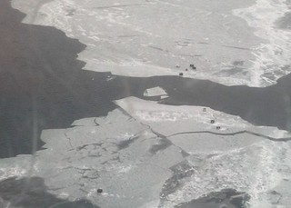 GREEN BAY, Wis. – Ice shanties belonging to seven people stranded on an ice floe are seen about 300 yards from Riley's Bay in Green Bay, Feb. 26, 2012. All seven individuals were safely assisted off of the ice by local authorities. U.S. Coast Guard photo courtesy of Coast Guard Air Station Traverse City, Mich.