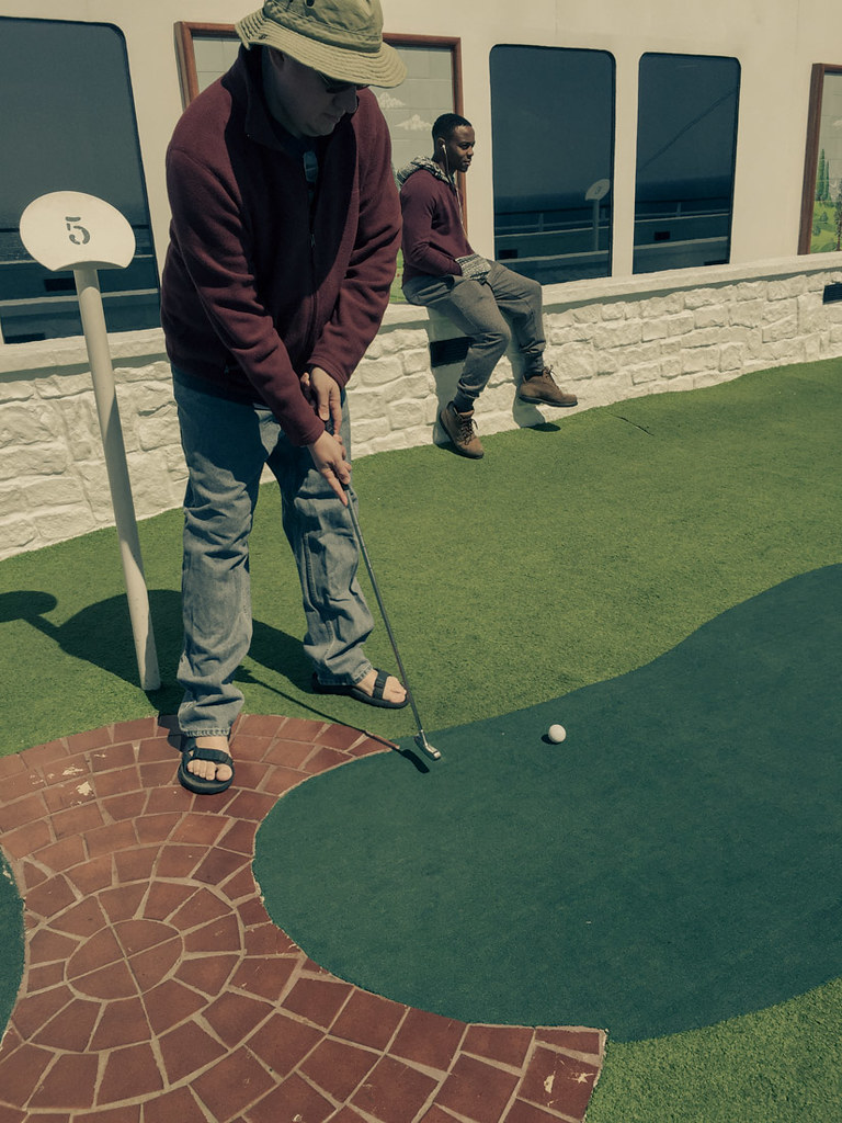 Ken playing mini golf on cruise ship