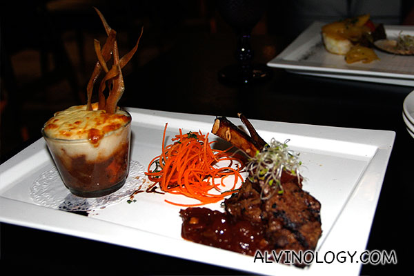 Two Way Lamb (shepherd pie and roasted marinated lamb rack, served with sautéed arugula and cherry tomato chutney) - S$35