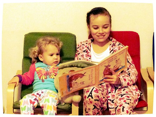 Eliana reading to Evie
