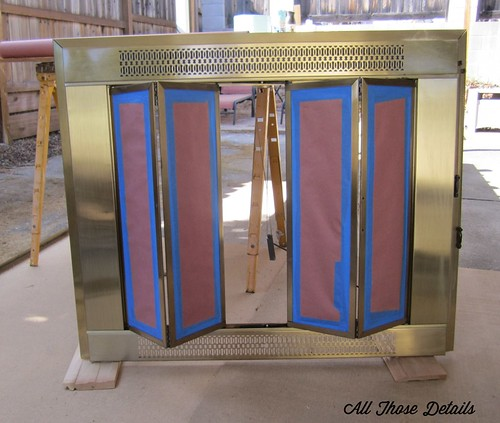 Painting brass fireplace doors was a great way to update our 1960s fireplace. Bonus