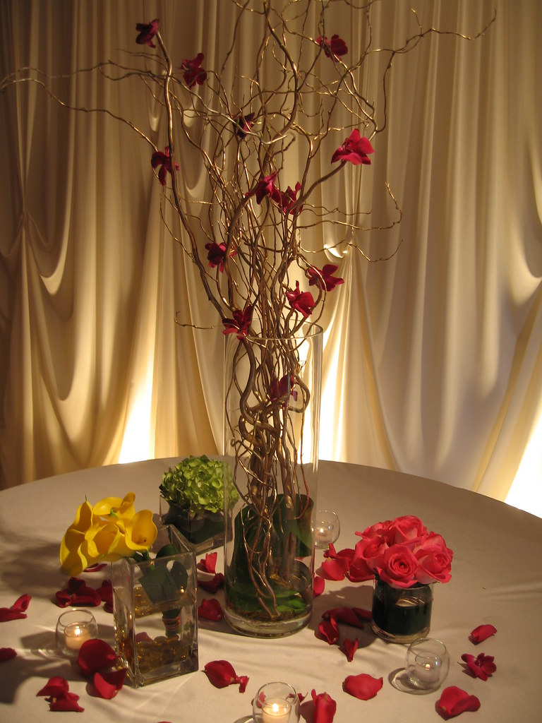 Wedding flowers tall table centerpieces wedding for Tall wedding table centerpieces