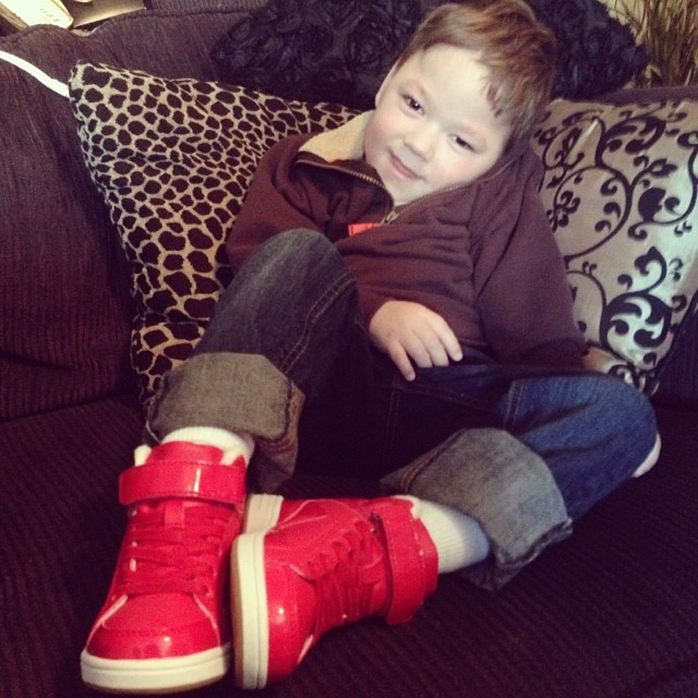 My big, happy boy wearing his new christmas shoes from me! #proudauntie #christmas2013 #redshoes #nephew #family