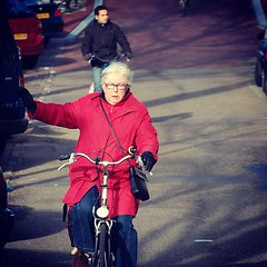 Lady cycling in Amsterdam