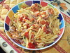 Seafood pasta with pancetta and tomatoes