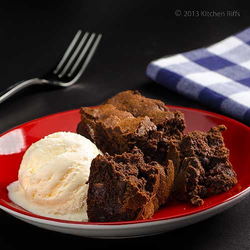 Chocolate Mascarpone Brownies on plate with vanilla ice cream