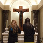 Cousins praying in a side chapel