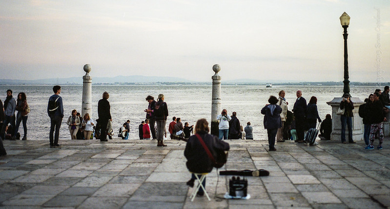 The lonely musician overlooking the Tagus River