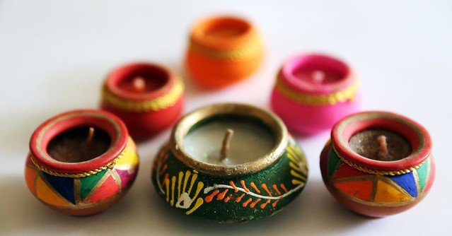 Festive coloured candle holders