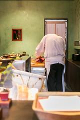 Apprentice cutting fish