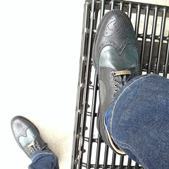 Rock\'n my new Italian leather shoes at the bus stop.