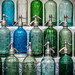Antique seltzer bottles for sale at the San Telmo street fair in Buenos Aires. by Phil Marion