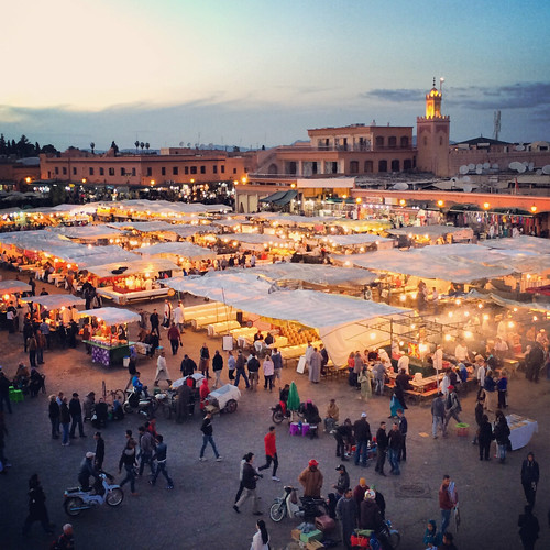 africa city travel blue people urban square place magic culture mosque unesco arabic busy morocco hour maroc marrakech afrika marrakesh arabian magical streetfood stalls marokko nightfall iphone marrakesch djemaaelfna instagram iphone5s