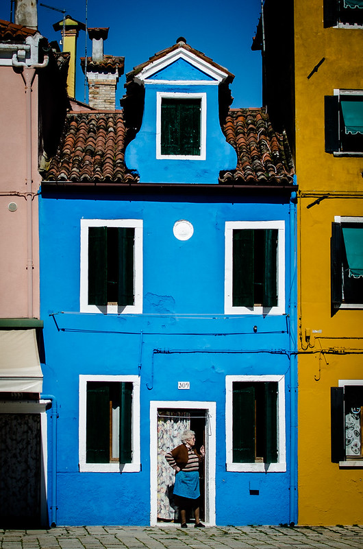 A resident of the island of Burano surveying the main square.
