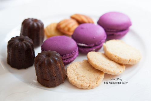 From the dessert tiers (Petit Four collection): Mini canelés, blueberry macarons, madelines, and butter shortbread cookies