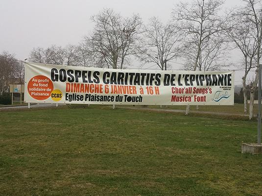 Réalisation d'une bâche grand format pour la promotion d'un concert de gospel.