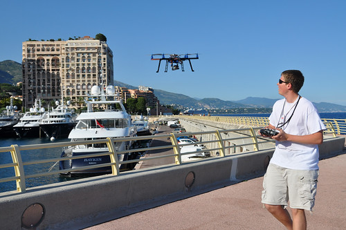 Ken Pesyna flies a hexacopter using a handheld remote controller on a pier in Port de Cap d'Ail.