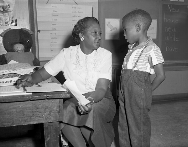 Unidentified first grade teacher with student in Tallahassee, Florida from Flickr via Wylio