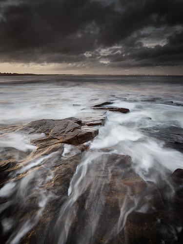 sunset seascape evening rocks northumberland desaturated seatonsluice nd09 rockyisland canonef1740mmƒ4lusm gnd045se