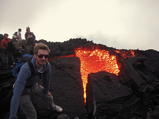 Standing near lava at the top of the Pacaya Volcano