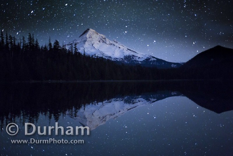 Mount Hood at night with stars reflected in Lost Lake.