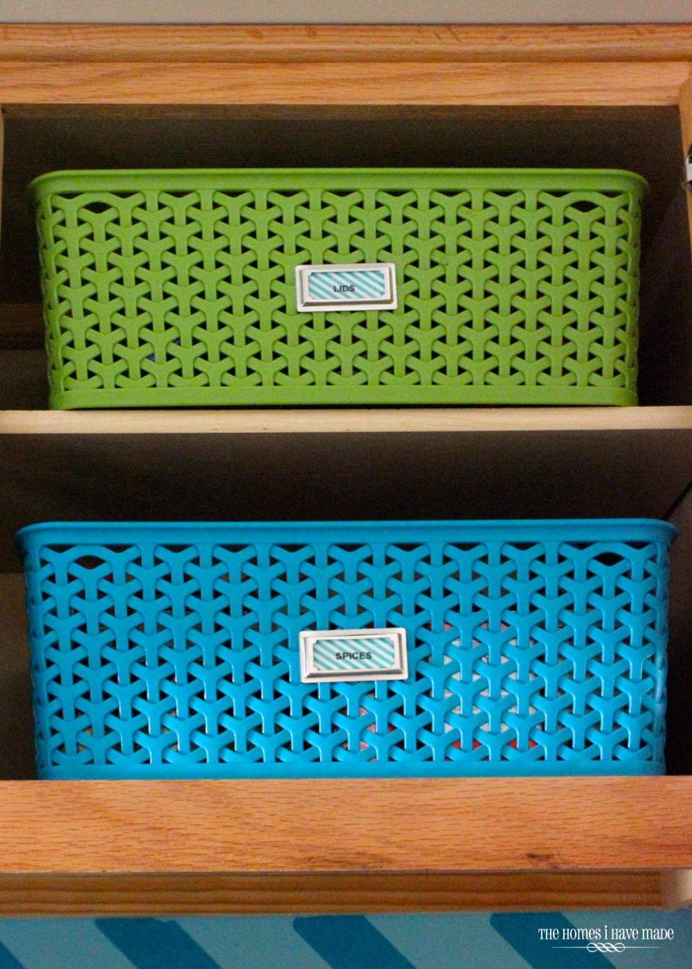 green and blue baskets in a little upper cabinet
