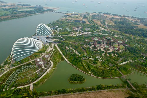 Gardens by the Bay with Supertree Grove, Flower Dome and Cloud Forest seen from the roof of the Marina Bay Sands Hotel, Singapore