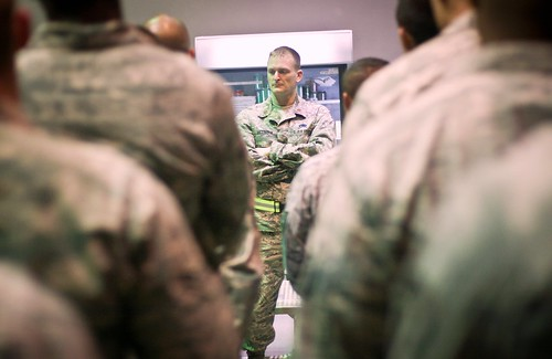 Maj. Matthew McCoppin conducts a briefing during a recent deployment to Al Udeid Air Base, Qatar. Photo courtesy: Matt Branson. Photos used with permission.