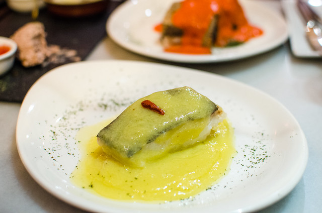 Cod smothered in garlic sauce at Sevilla's Vinería San Telmo.