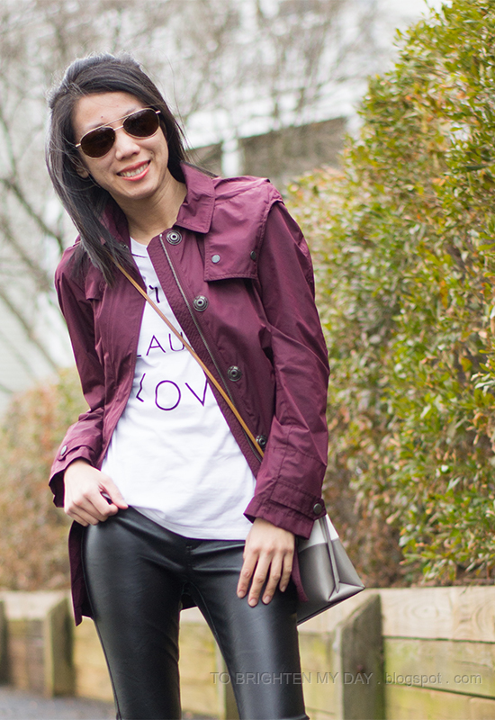 dark red jacket, graphic tee, faux leather pants, colorblock bag