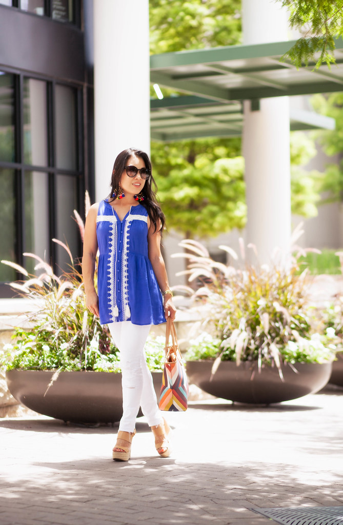 cute & little blog | petite fashion | blue white embroidered linen tassel tank, distressed white jeans, nude espadrille wedges, tassel statement earrings, tory burch tote | summer outfit