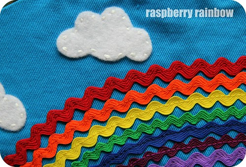 Rainbow, with a chance of fluffy felt clouds.