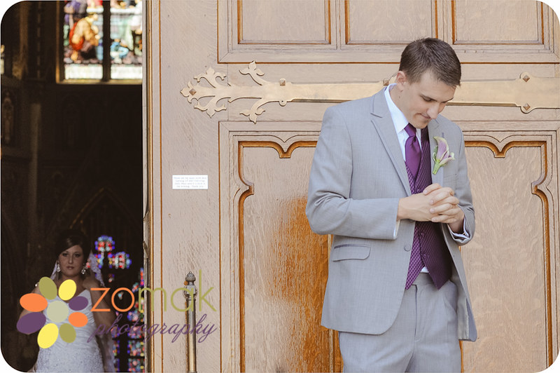 a groom patiently awaits his bride outside the St Helena Cathedral in Helena, Montana, moments before their first look