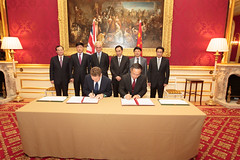 Gregory Barker and Zhu Xiaodan signing the statement