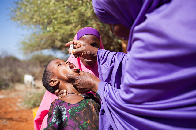 Sahro Ahmed vaccinates a child