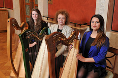 Culture Minister Carál Ní Chuilín with Caitlin Ńi Cheallaigh (left) and Áine Brolly (right) from Scoil Ruairí Dall harpists, at an evening of music at Stormont to celebrate Seachtain na Gaeilge and Líofa.