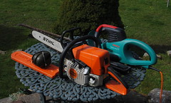 riding mower(0.0), vehicle(0.0), tractor(0.0), outdoor power equipment(1.0), machine(1.0), tool(1.0), chainsaw(1.0),