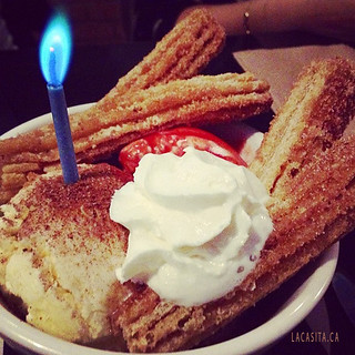 Churros, vanilla ice cream and a candle in Vancouver BC