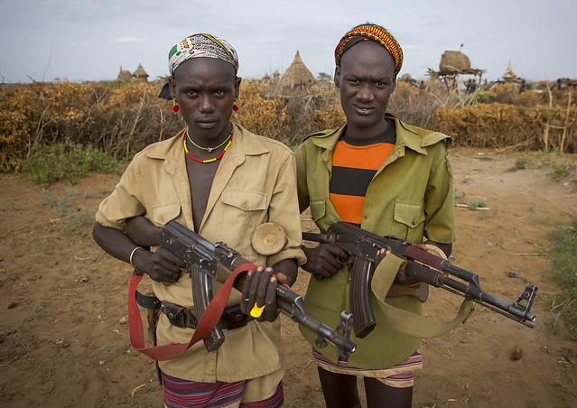Dassanech Men With Their Guns, Omorate, Omo Valley, Ethiopia