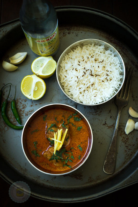 Korma Curry and rice in metal bowls pictured in Metal Tray with other ingredients close by