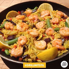 caridean shrimp(0.0), shrimp(1.0), seafood boil(1.0), paella(1.0), seafood(1.0), produce(1.0), food(1.0), scampi(1.0), dish(1.0), cuisine(1.0), jambalaya(1.0),